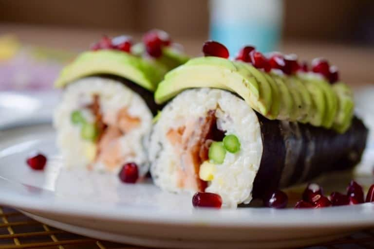 closeup of paleo sushi with avocado and pomegranate