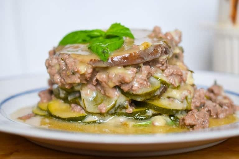 beef and cooked vegetables topped with basil