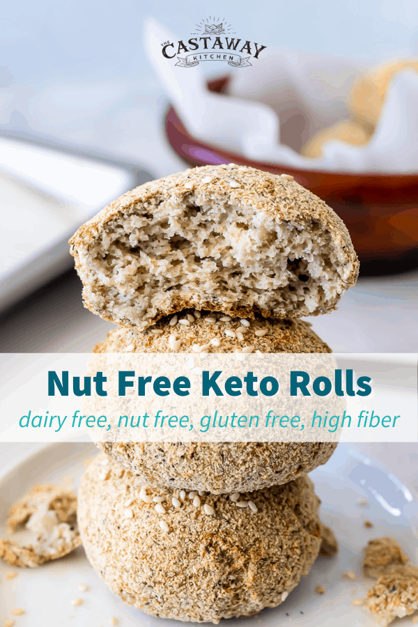 Nut Free Keto Rolls stacked on a small white plate with the top roll torn in half.